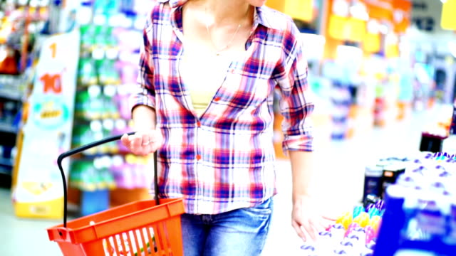 Woman buying cosmetic products in supermarket. video