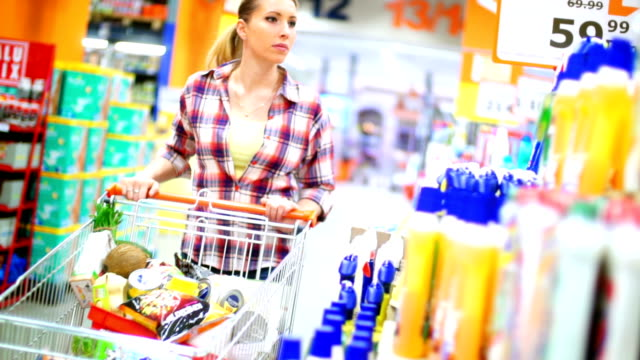 woman buying cosmetic products in supermarket. - lysol stock videos & royalty-free footage