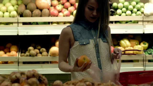 Woman buying groceries in supermarket video
