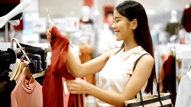 Woman Buys A T-Shirt In The Store