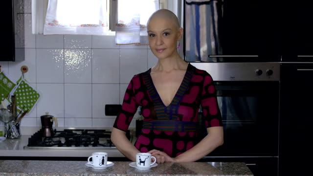 woman cancer survivor prepares coffee at home: relax, life, faith, vitality video
