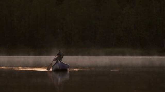 Woman canoeing at dusk video