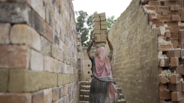 Woman carrying bricks on her head Working in brick factory sari stock videos & royalty-free footage