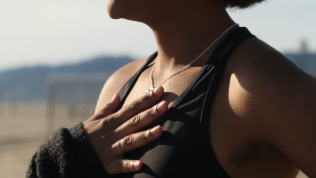 woman catching her breathe after workout - torace umano video stock e b–roll