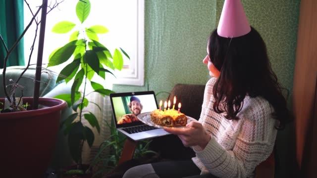 Woman celebrating birthday during quarantine Covid-19