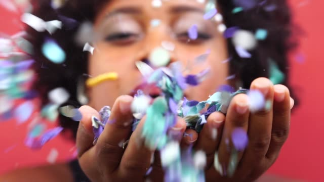 Woman Celebrating Life With Confetti Carnival in Brazil carnival celebration event stock videos & royalty-free footage