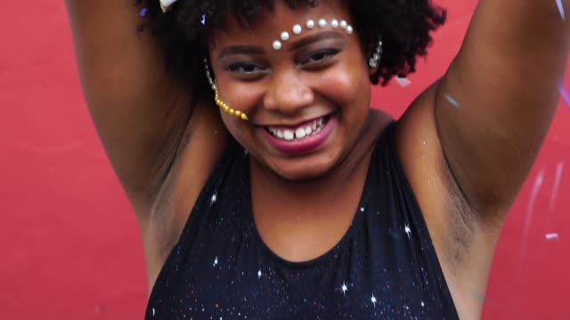 Woman Celebrating Life With Confetti Carnival in Brazil funky stock videos & royalty-free footage