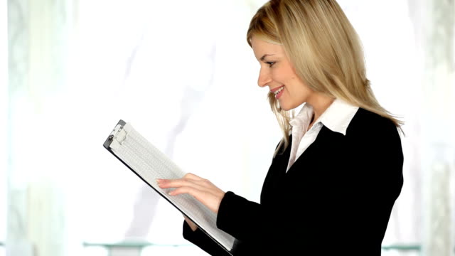 Woman checking a documents. video