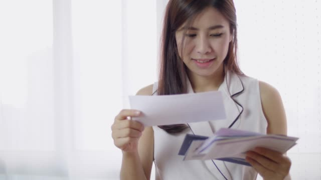 Woman Checking Pay Bill And Tax