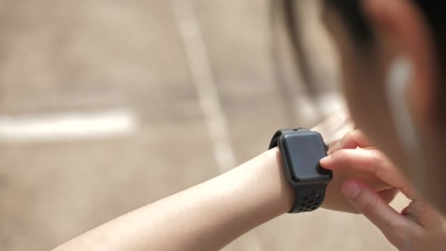 Woman checking pulse on Smart watch, Wearable Computer Woman checking pulse on Smart watch, Wearable Computer wristwatch stock videos & royalty-free footage