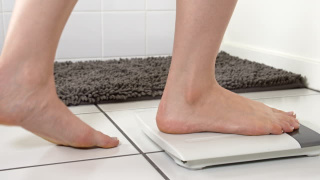 Woman Checking Weight Bathroom Scale video