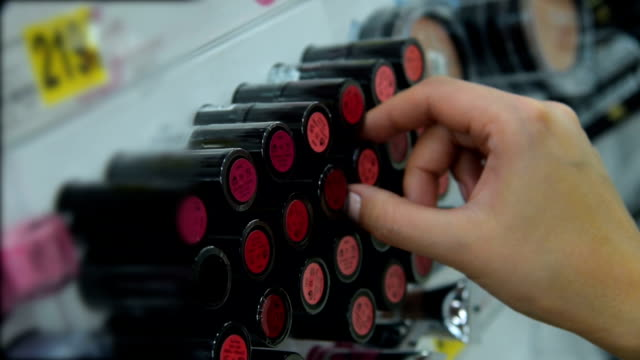 woman choosing a lipstick - make up stock videos & royalty-free footage