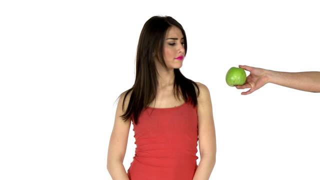 Woman choosing between chocolate and apple video