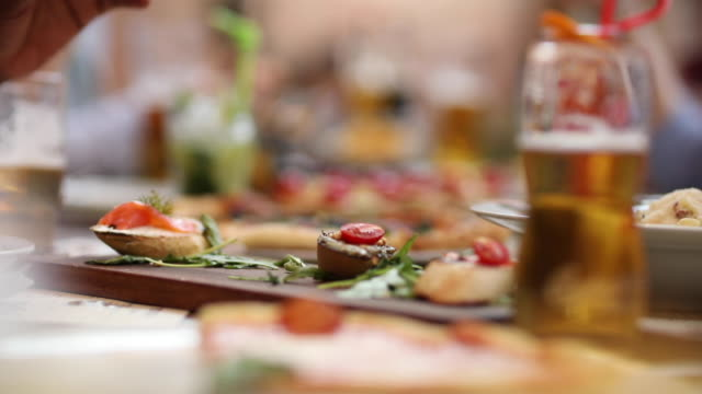 Woman choosing canape at outdoor restaurant