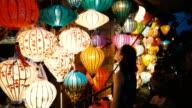 istock Woman choosing lanterns in Hoi An 951067938