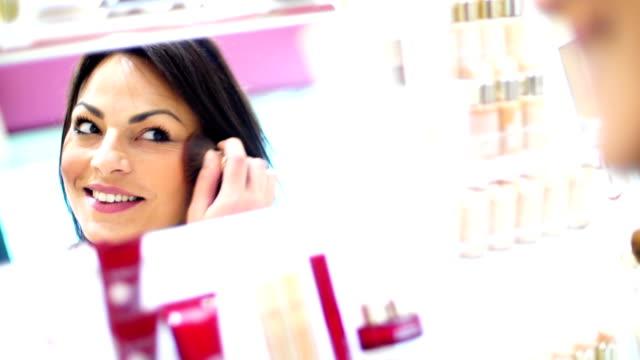 Woman choosing makeup at beauty store. video
