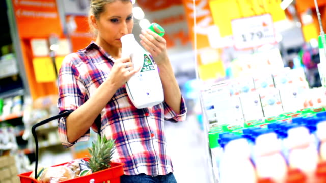 woman choosing some food in supermarket. - disinfectant stock videos & royalty-free footage