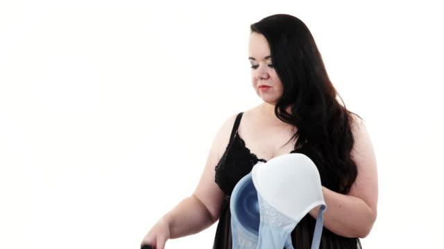 Woman choosing witch bra to wear video