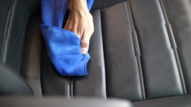 SLO MO, Woman clean her car seat