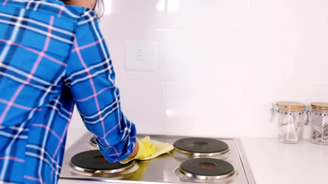 Woman cleaning the cooker video
