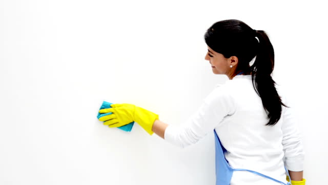 Woman cleaning the walls video