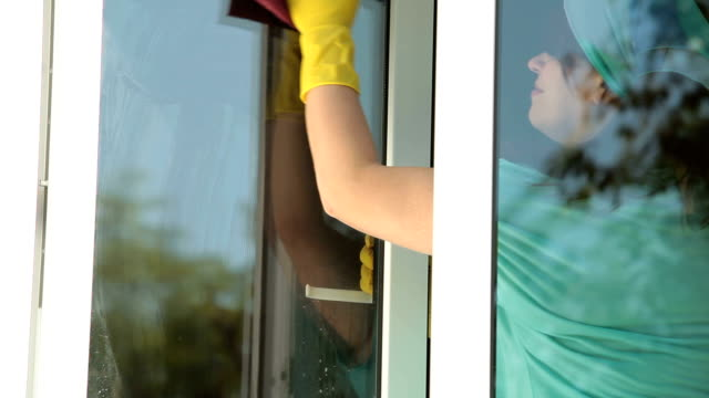 Woman cleaning the window video