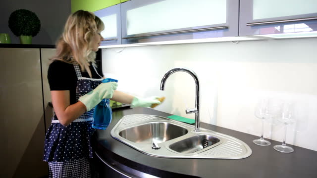 Woman cleans kitchen sink video