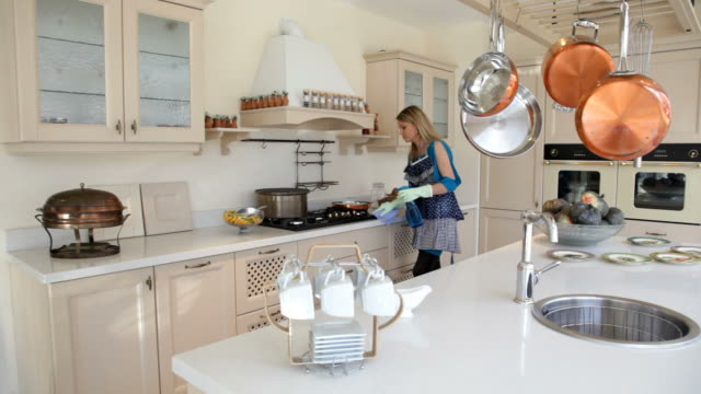 Woman cleans the cooker in kitchen Washing dishwashing liquid stock videos & royalty-free footage