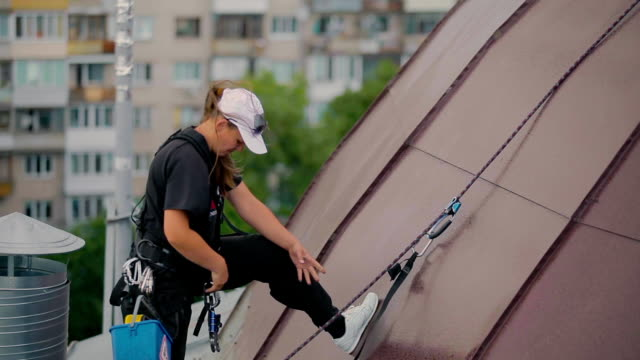 Woman climber checks the safety of the outfit video