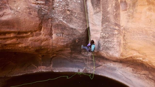 Woman Climber Rappelling in Moab Utah