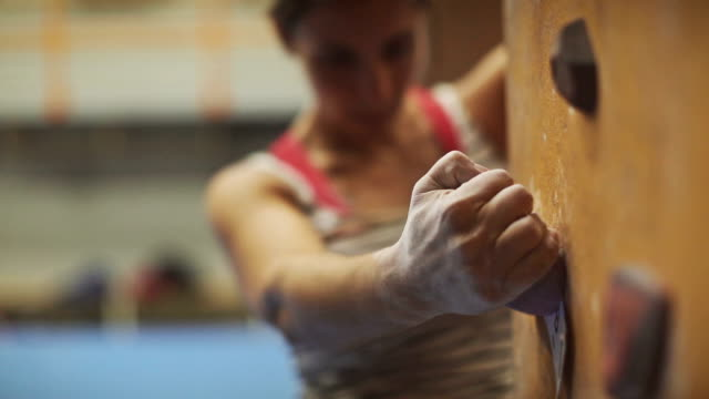 Woman climbing and bouldering video