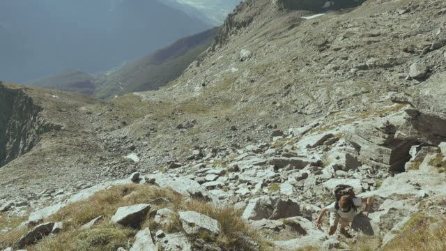Woman climbing on the Italian French Alps video