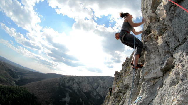 Woman climbing sport route in Turzii Gorge video