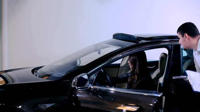 Woman close the sunroof of electric car video