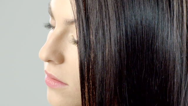 Woman combing her hair Woman with long healthy looking hair. Recorded by the camera RED scarlet at 2k. Color correction professionally done. human hair stock videos & royalty-free footage