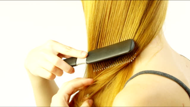 Woman combing her hair. video