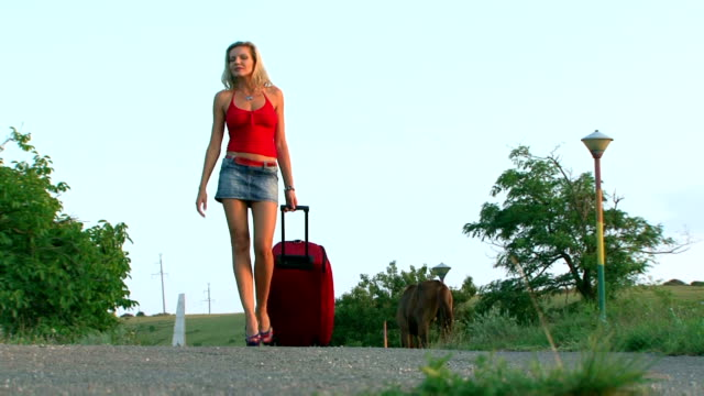 Woman comes with a big red bag video