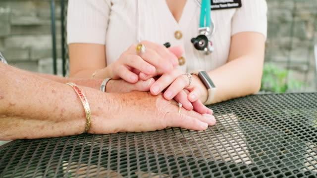 Woman Comforting Elderly Friend - video