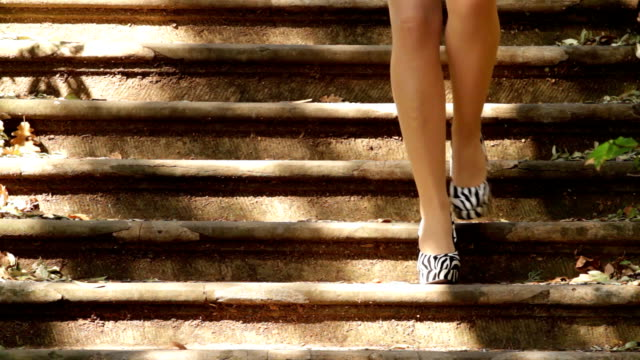 Woman coming down the stairs in high heels. video