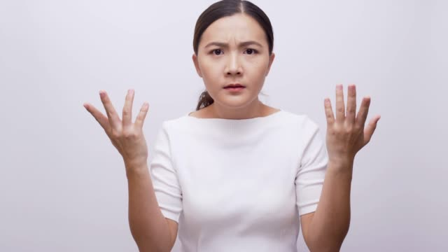 Woman confused look at camera on isolated blue background 4k Woman confused look at camera on isolated blue background 4k human joint stock videos & royalty-free footage