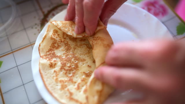 woman cooks pancakes with curd. - eastern european descent stock videos & royalty-free footage