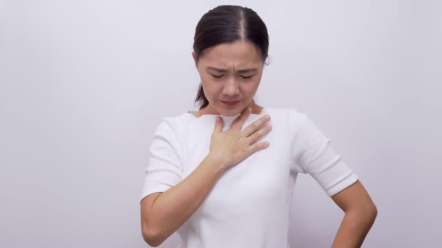 Woman coughing on isolated white background 4k