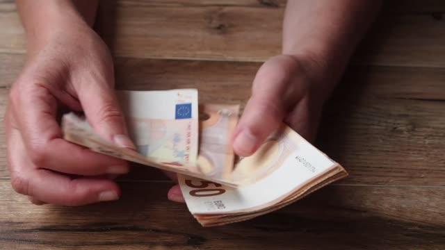 woman counting  euros - valuta dell'unione europea video stock e b–roll