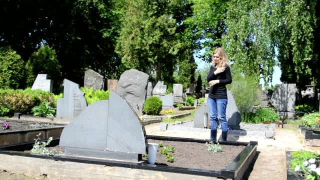 woman cross cemetery video