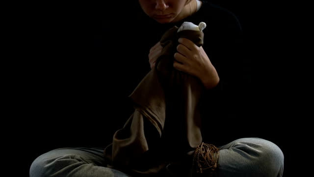Woman crying swaddling toy in scarf, pain of miscarriage, psychological trauma Woman crying swaddling toy in scarf, pain of miscarriage, psychological trauma human trafficking stock videos & royalty-free footage