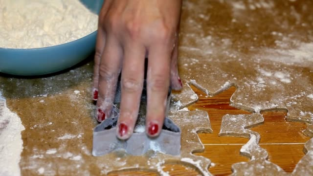Woman cutting different shaped gingerbread cookies video