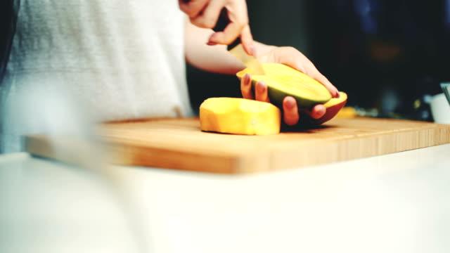 Woman Cutting Mango'S Pulp On Cutting Board Closeup of woman cutting mango's pulp on cutting board mango stock videos & royalty-free footage