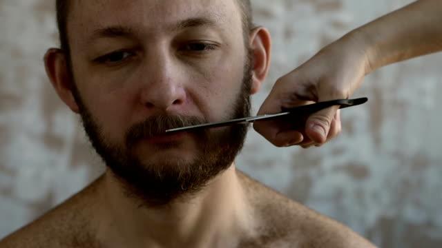Woman cutting man's moustache video