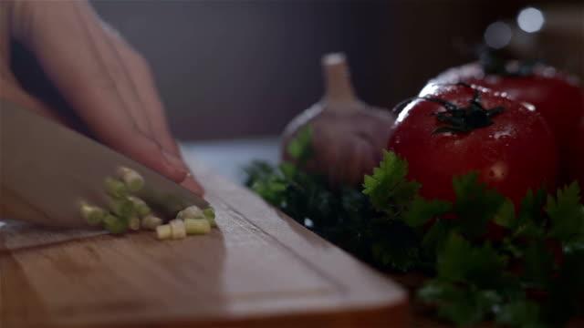 woman cutting onions video