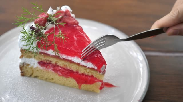 Woman Cutting Strawberry Cake in Slow motion